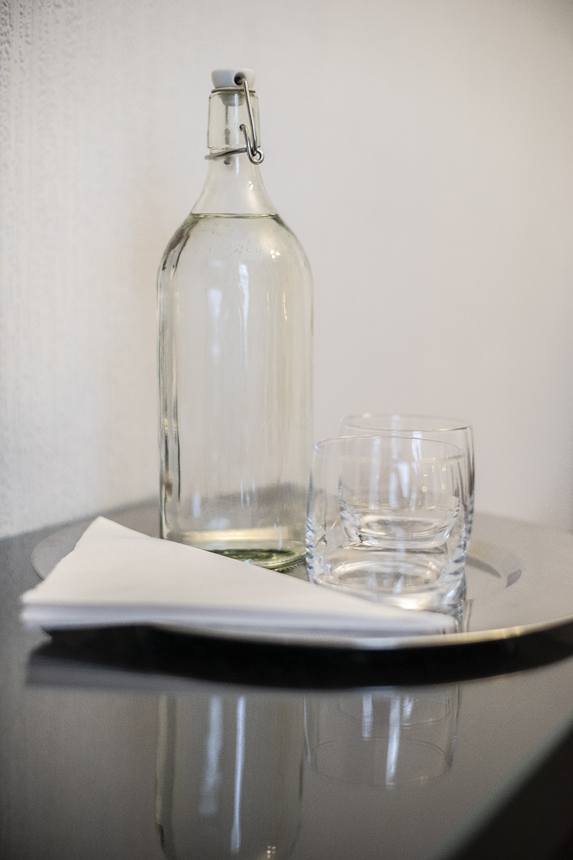 Queensberry House bottled water in room