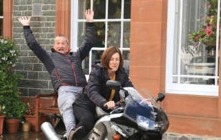Queensberry House hosts on a bike